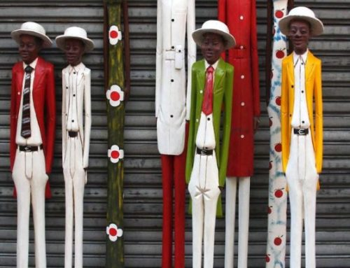 African Hand Carved Wooden Colonial Figures