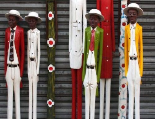 African Hand-Carved Wooden Colonial Figures