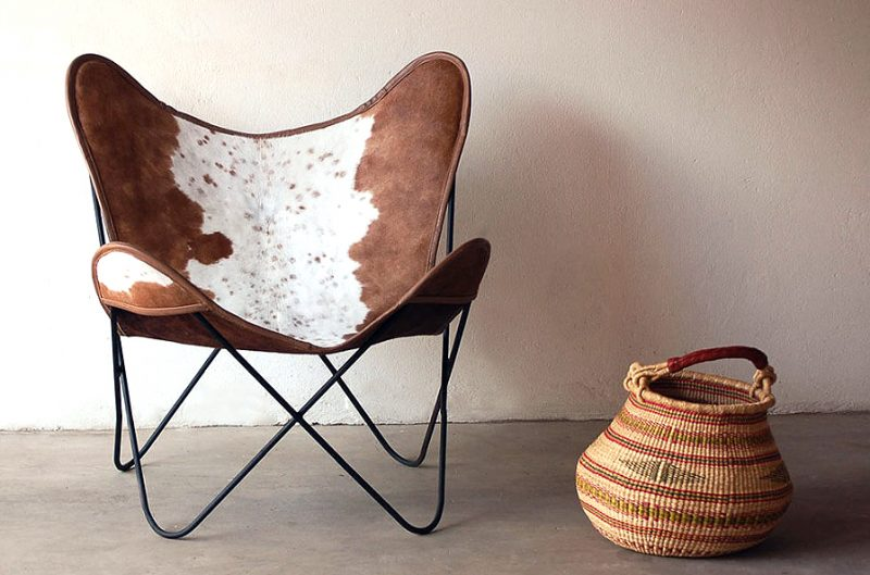 african furniture│These mid-century modern cowhide chairs, were made using Nguni hair-on-hide leather and superb quality steel frames. Natural (Nguni) cowhide colours: black, grey, brown and white. These one-of-a-kind chairs cannot be duplicated as each cowhide is completely unique. Please contact us for additional images should you prefer one of the above mentioned available colours.