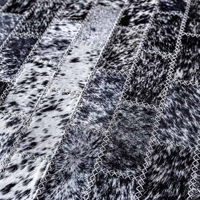 Detailed View - handstiched cowhide Rugs - black and white